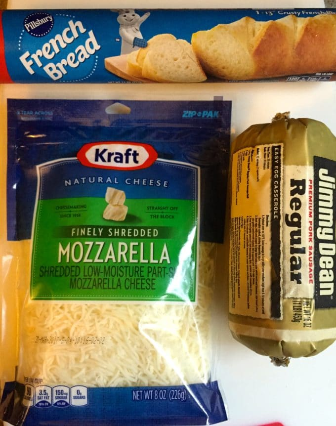 A bag of mozzarella cheese, canned French bread dough and pork sausage.