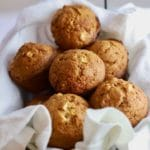 Easy Apple Cranberry Muffins in a basket and ready to eat