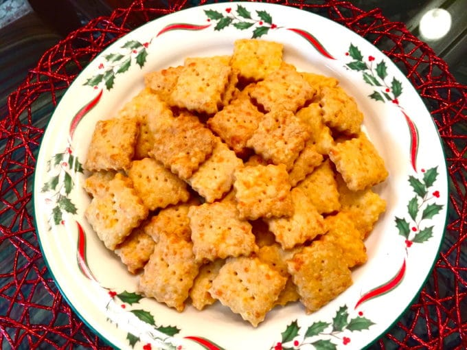 A Christmas plate with a pile of homemade baked cheez its.