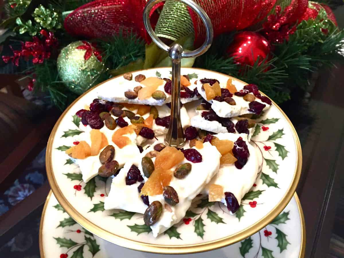 White chocolate bark candy on a Christmas plate.