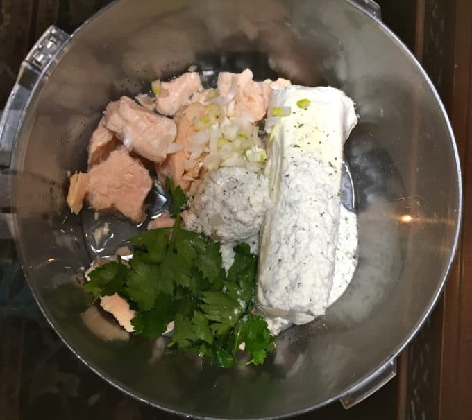 Chicken, cream cheese, dry ranch dressing and parsley in the bowl of a food processor.