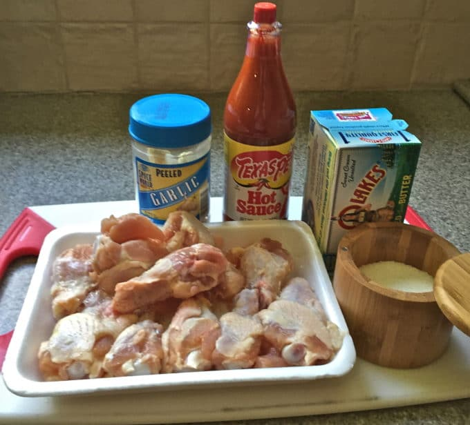 Baked Buffalo Wings and Buffalo Sauce ingredients, including chicken wings, hot sauce and butter.