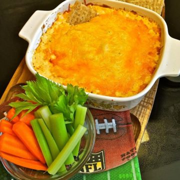 Buffalo Chicken Dip with carrot and celery sticks.
