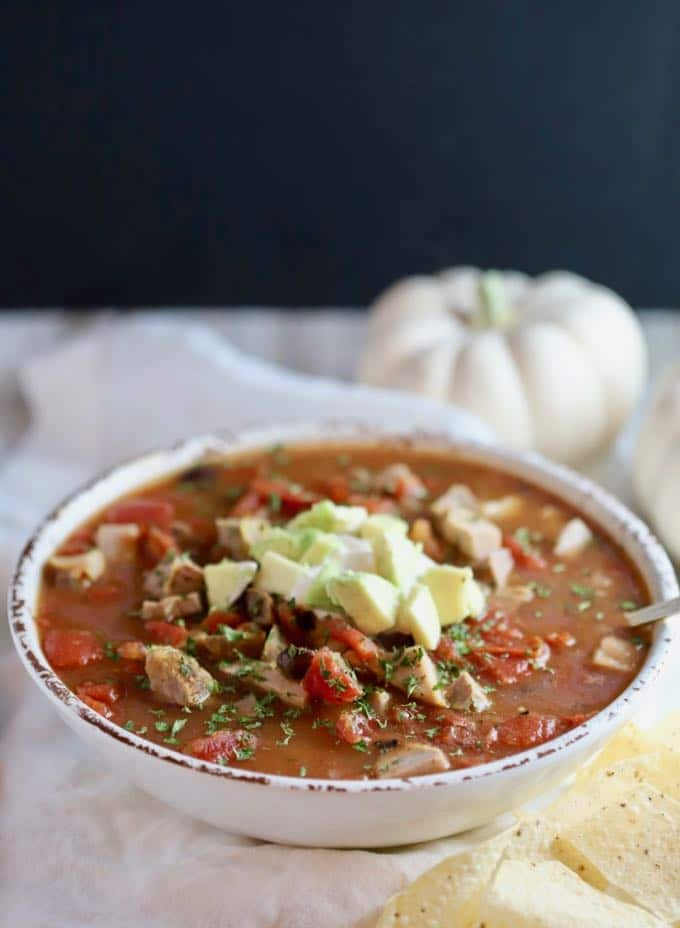 Quick and Easy Mexican Pork Stew topped with sour cream and avocado