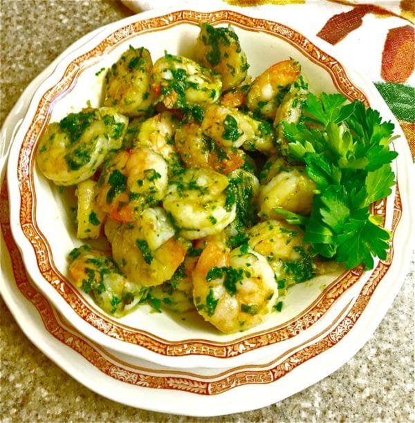 Spicy Shrimp in Green Sauce in a white bowl and garnished with parsley