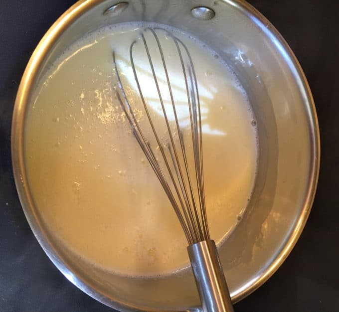 Cooking cream in a saucepan.