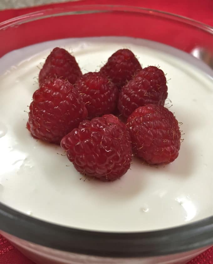 Raspberries and Cream Dessert topped with fresh raspberries