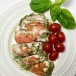 Quick and Easy Basil Pesto Chicken on a plate garnished with basil and cherry tomatoes