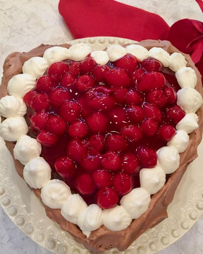 Chocolate Cherry Valentine Torte baked in the shape of a heart with cherries in the middle