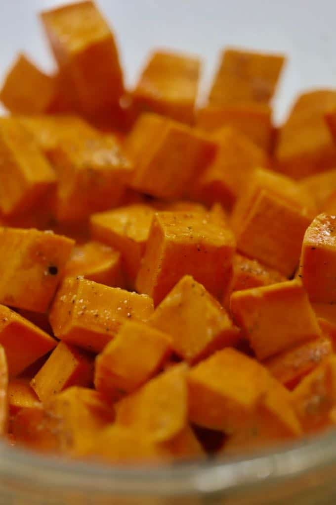 A bowl of cut up sweet potatoes.