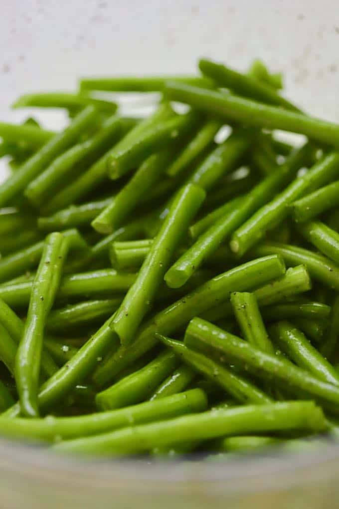 A bowl of cut up fresh green beans.