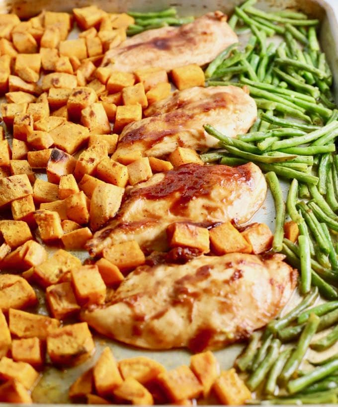 One Pan BBQ Chicken, Potatoes, and Green Beans on a sheet pan right out of the oven.
