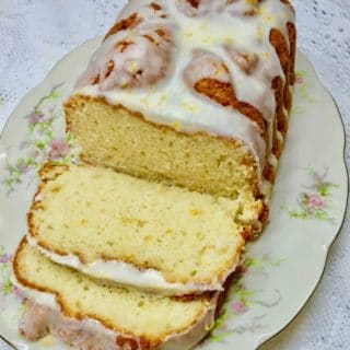 Southern Style Limoncello Cake sliced on a China platter.
