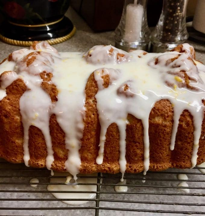 Southern Style Limoncello Cake adding the glaze