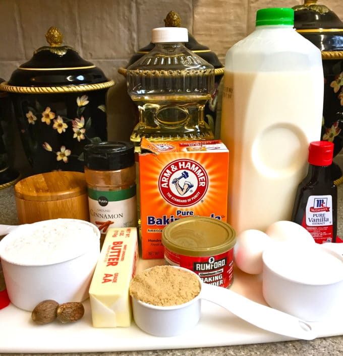 Ingredients for donuts including milk, baking soda, baking powder, sugar, eggs and sugar.