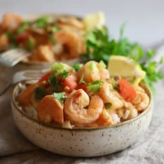 Two bowls of creamy shrimp creole over rice.