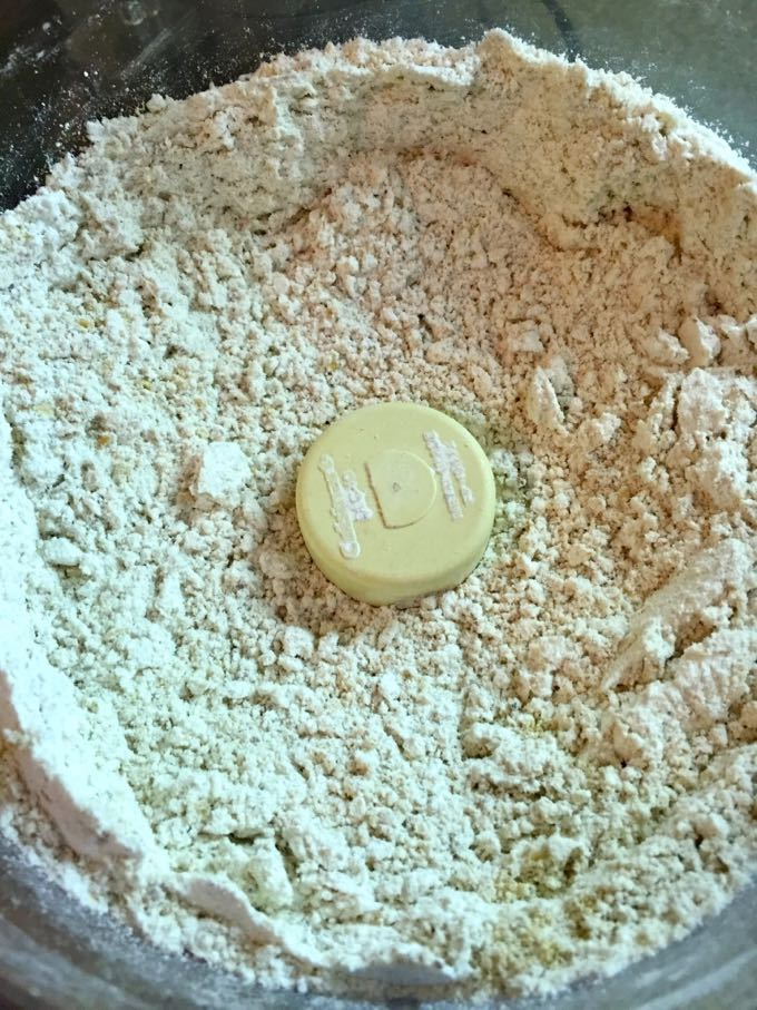 Using a food processor to combine oat flour with the rest of the dry ingredients for oatmeal muffins.