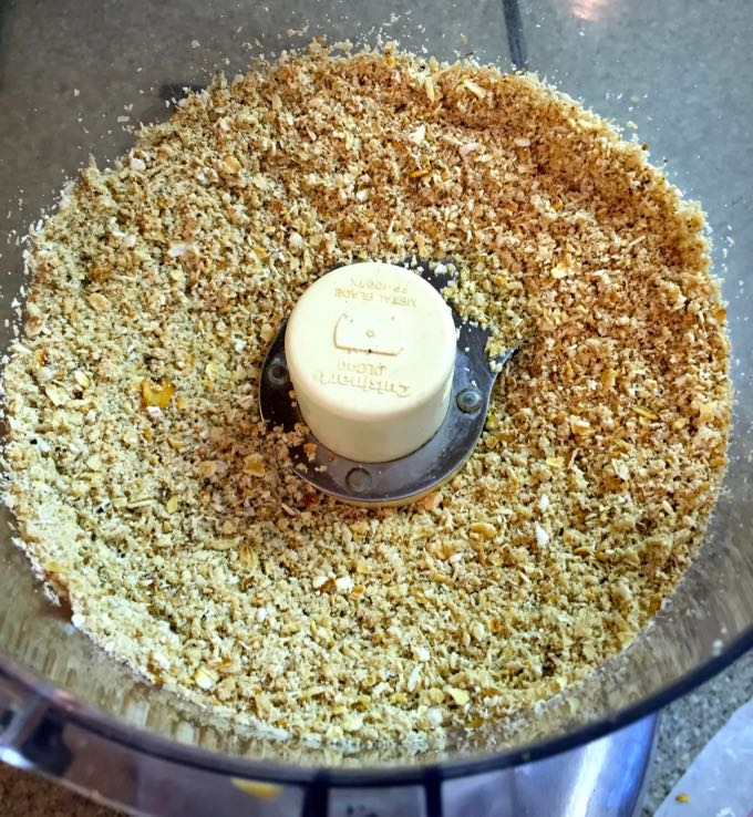 Grinding oatmeal into flour using a food processor.