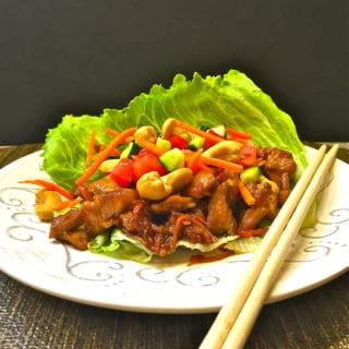 Easy Healthy Chicken Lettuce Wraps with chop sticks and ready to eat