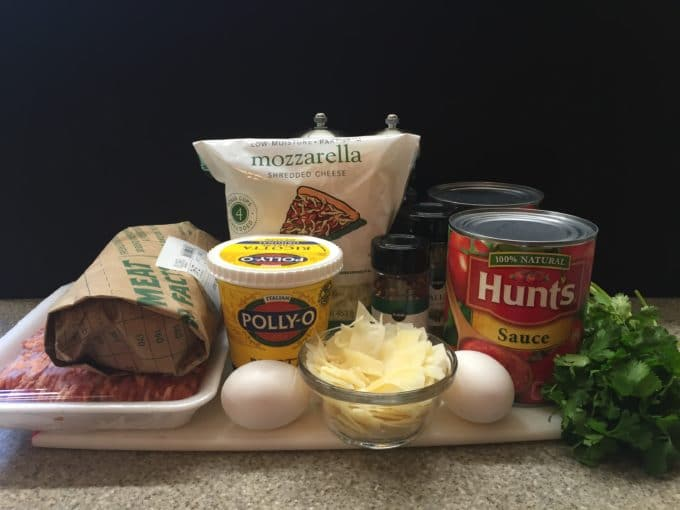 Ingredients for Easy Make Ahead Baked Ziti including sausage, cheese and tomato sauce