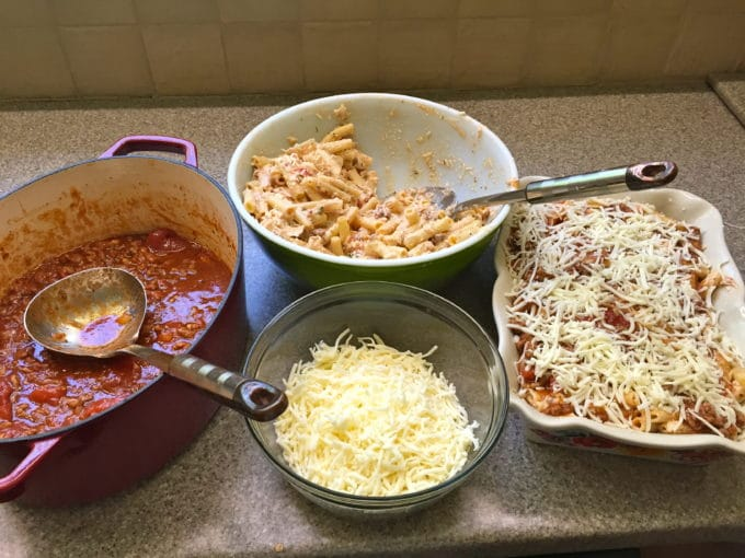 Tomato meat sauce, cheese, ziti in bowls for Easy Make Ahead Baked Ziti