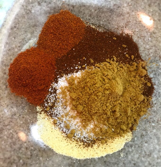 Chili- rub ingredients in a large glass bowl.