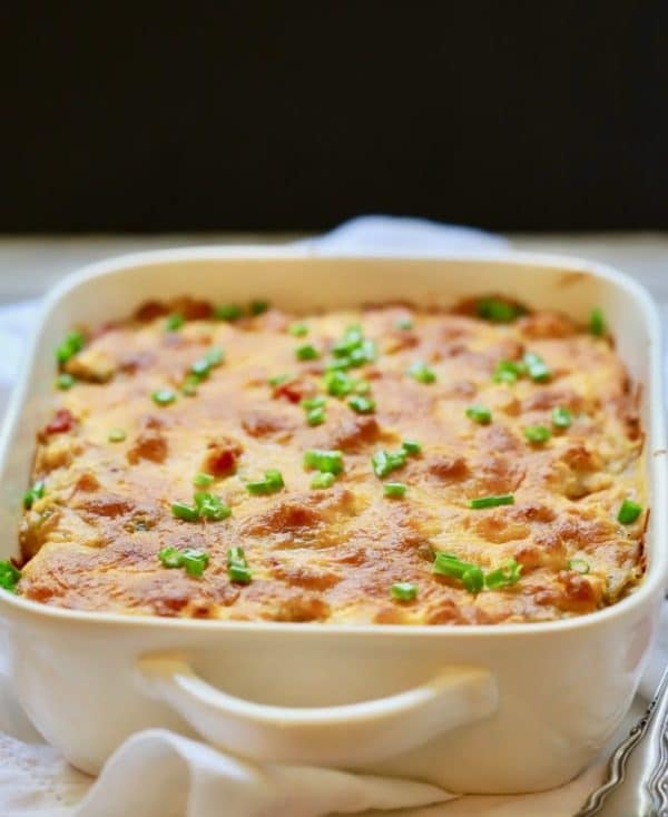 Classic King Ranch Chicken Casserole in a white baking dish garnished with chopped chives