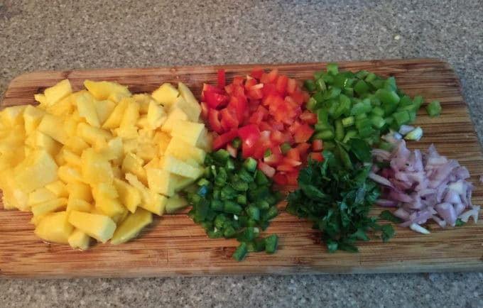 Chopped up mango, red and green bell pepper, jalapeños and red onion for Grilled Grouper and Mango Salsa