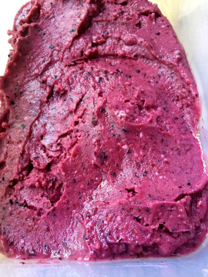 A container of Easy Mixed Berry Sherbet ready to put in the freezer.