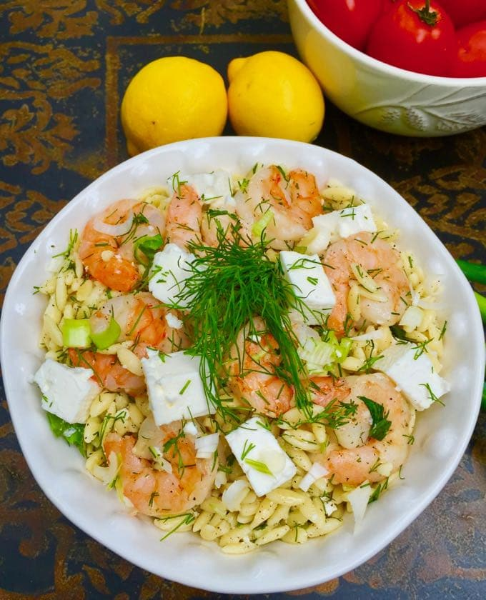Easy Shrimp Salad with Pasta topped with feta and dill in a white serving dish