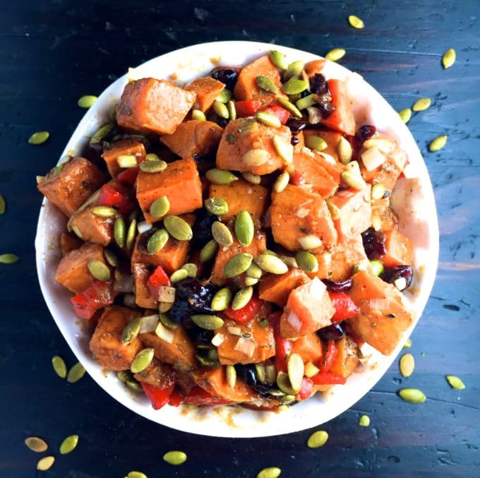 Sweet Potato Salad in a white bowl topped with sunflower seeds.