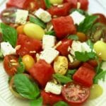Southern Watermelon Tomato Salad garnished with fresh basil