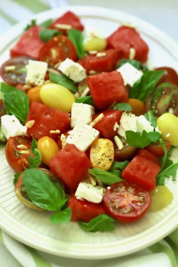 Southern Watermelon Tomato Salad garnished with fresh basil