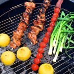 Grilled Chicken Skewers with Tomato Relish on the grill