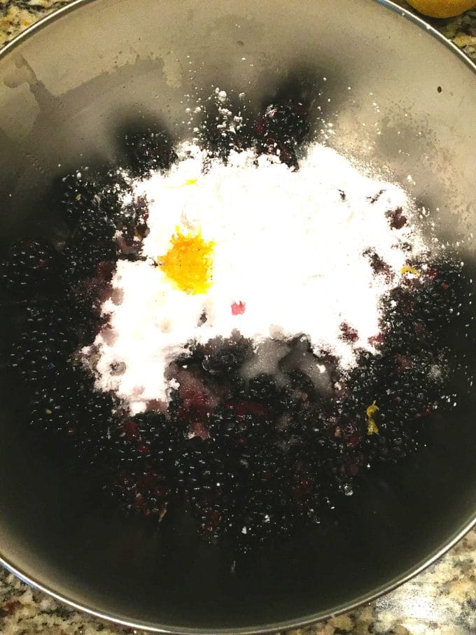Classic Southern Style Blackberry Pie mixing the pie filling