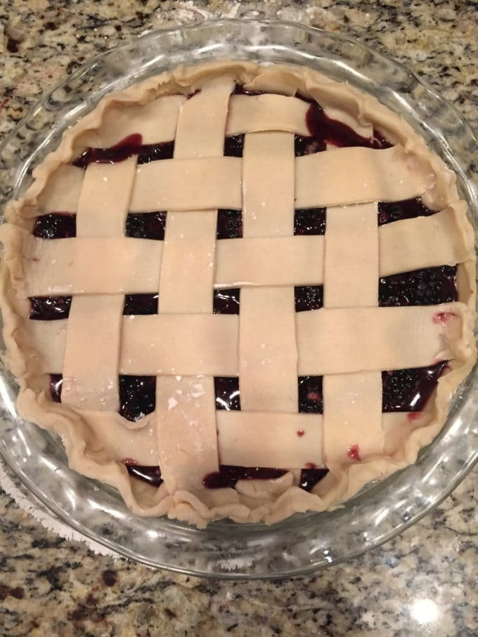 A blackberry pie with a lattice crust ready to bake!