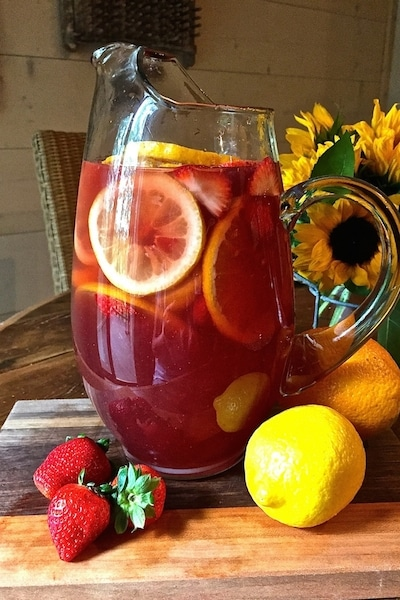 Summer Rosé Sangria is a perfect choice for happy hour on one of our warm summer evenings. It's fun, light and lively and shouts