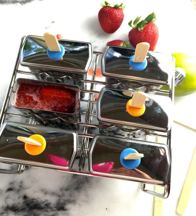 Ice pop metal molds full of strawberry margarita mixture for Strawberry Margarita Ice Pops