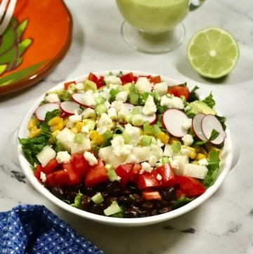 Mexican Chopped Salad with Honey Lime Dressing in a white bowl and ready to serve