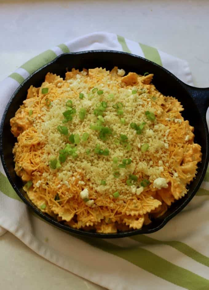 Unbaked Buffalo Chicken Pasta Bake in a cast-iron skillet.