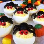 Halloween deviled eggs on a plate.