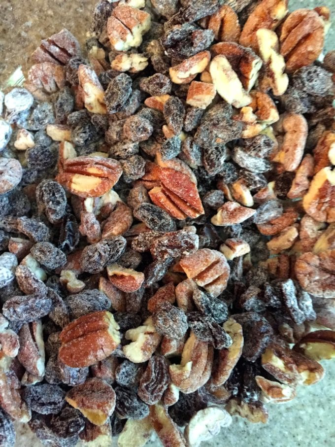Tossing pecans and raisins together with flour before adding to the batter for Easy Carrot Cake with Cream Cheese Icing