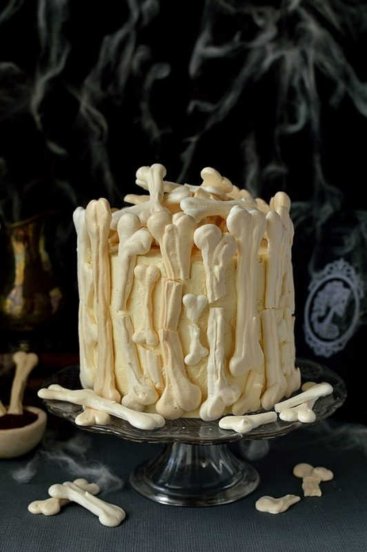 meringue-bone-palace-halloween-cake-moist-chocolate-cake-filled-with-vanilla-swiss-meringue-buttercream-and-raspberry-jam-covered-in-meringue-bones-with-berry-coulis-blood-on-the-side