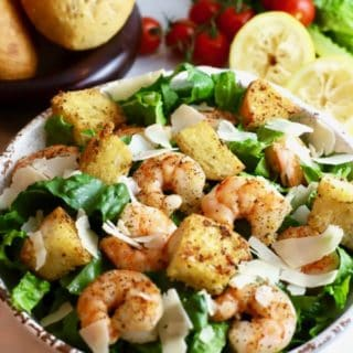 Shrimp Caesar Salad with Homemade croutons and homemade dressing in a bowl.