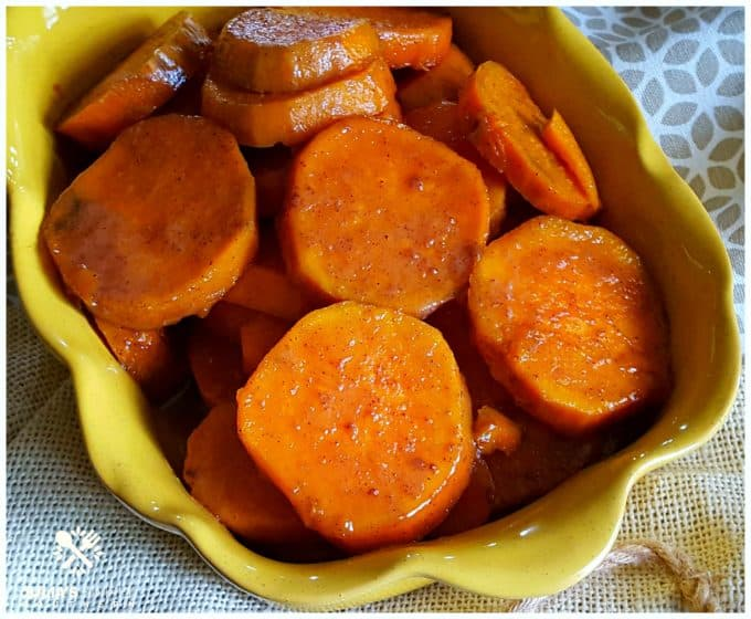 Candied yams in a yellow baking dish.