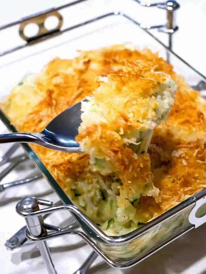 A clear glass baking dish with Zucchini Gratin in it.