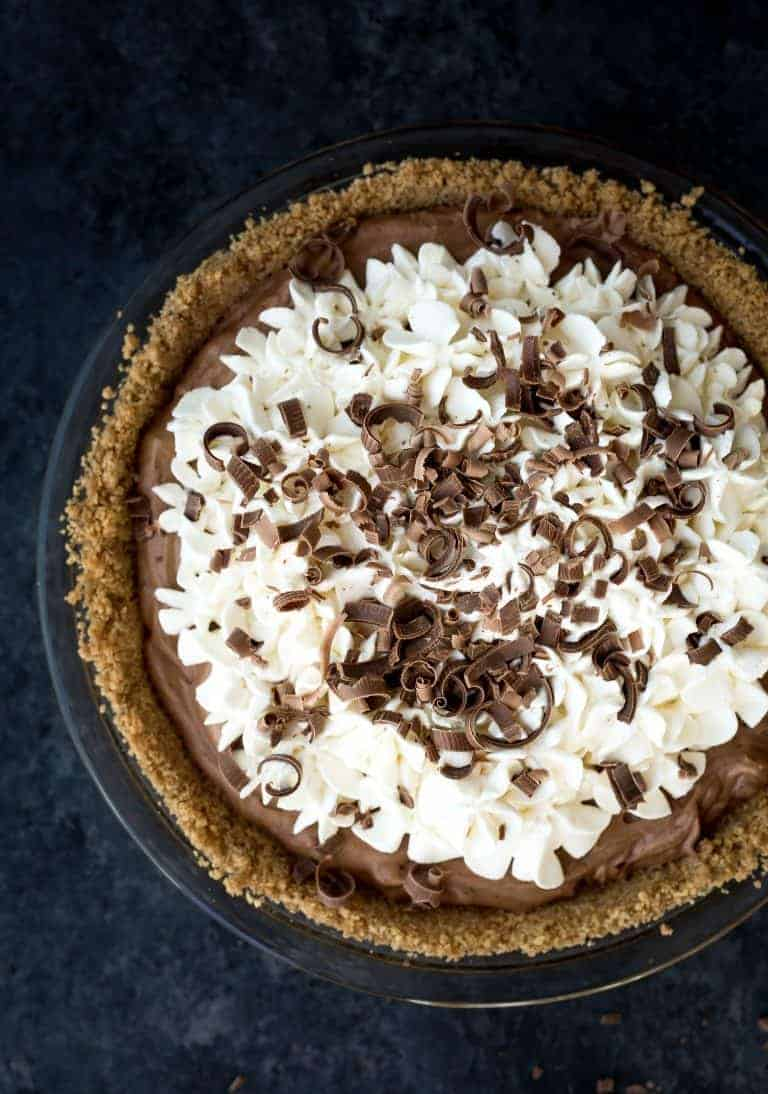 A whole french silk chocolate pie topped with whipped cream.