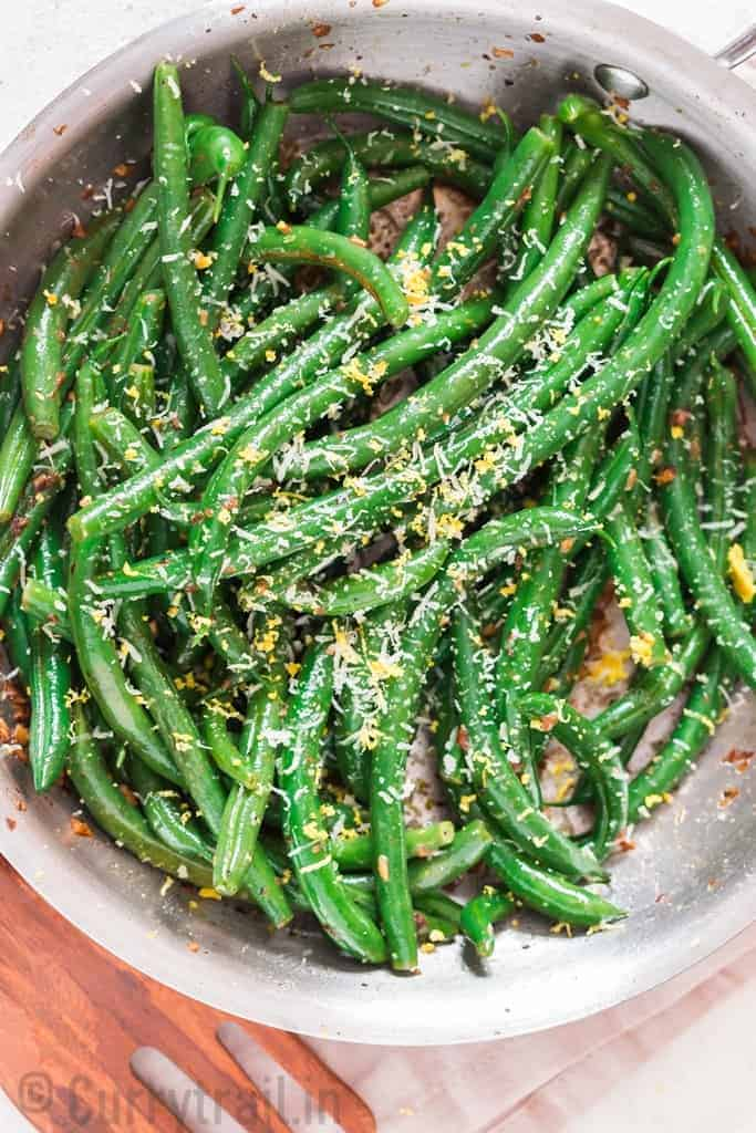 Green Beans sauteed in garlic butter, topped with parmesan cheese.