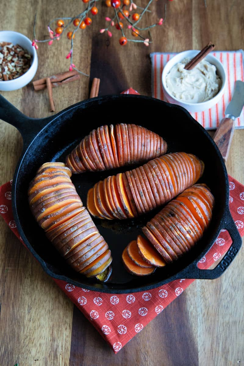 Hasselback Sweet Potatoes in a Cast Iron Pan.