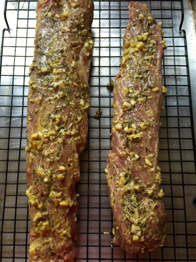 Herb Crusted Roasted Pork Tenderloin on a baking rack ready to go in the oven